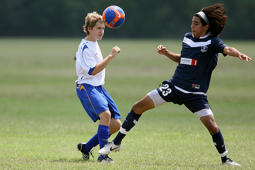 two young athletes playing soccer